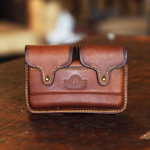 The Somerset Classic Cartridge Pouch, yellow stitching, logo, leather product, brass studs, handcrafted