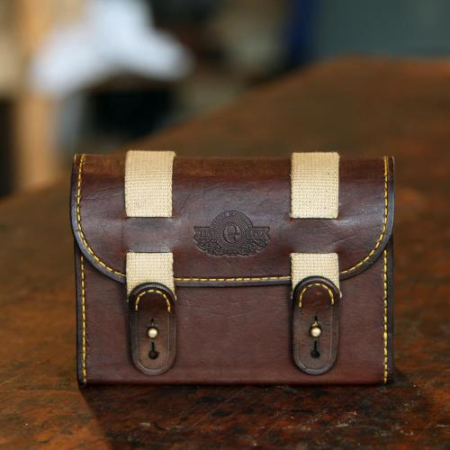 The Barkly Cartridge Storage Pouch, leather product, handcrafted, brass studs, cotton canvas straps, logo