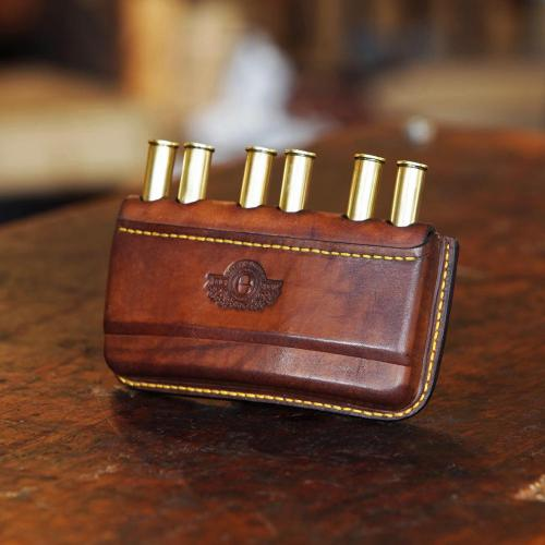 The Somerset Double Rifle Cartridge Pouch, cartridges, bullets, leather product, yellow stitching, logo