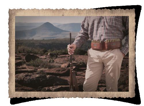 The Cradock Culling Belt, leather product, handcrafted, hunting, leather belt, cartridges, gun, landscape, s=rocks, hills, trees